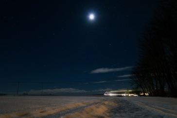 Kvällsbild på lagårn och stjärnhimmel